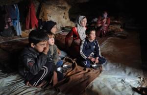 Fleeing bombardment of their village by Syria's Assad regime,